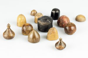 fig 1: Playing pieces made from bone, ivory, jet, and stone from the Coppergate excavations, which are on display at the Jorvik Viking Centre, © York Archaeological Trust