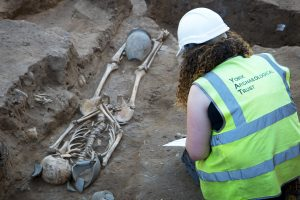 fig2: Archaeologist at work on the Newington Hotel site, © York Archaeological Trust