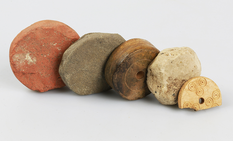 Gaming counters were made of different materials such as stone, fired clay or bone and could have been used for a variety of board games.