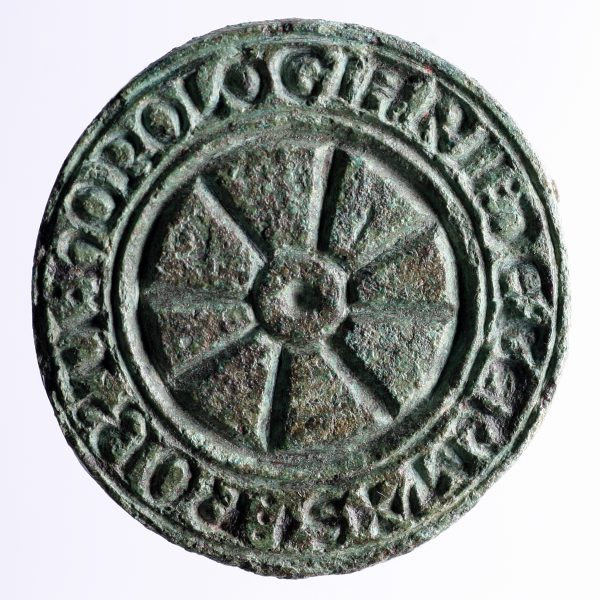 Seal matrix found at Low Petergate depicts a central motif of an eight-spoked wheel, and an inscription which reads 'The seal of Robert the clockmaker from Yarmouth