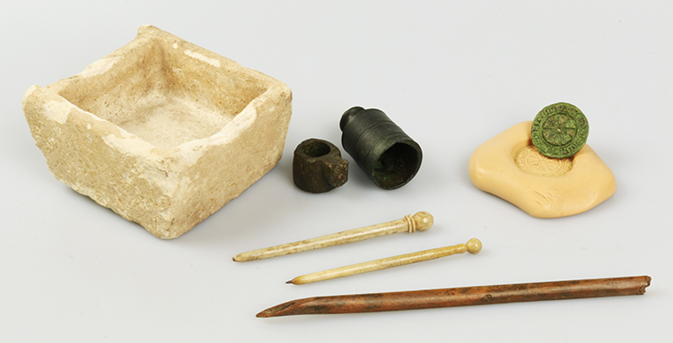 A medieval writing desk could have featured objects such as bone pens and parchment prickers, copper alloy seal matrices, candleholders and stone lamps