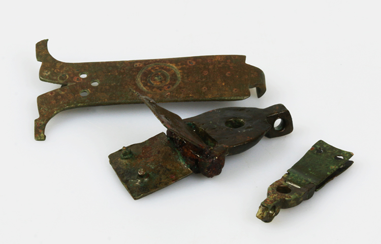 Leather straps with metal clasps such as these helped to keep books shut. Clasps came in a variety of shapes and sizes.