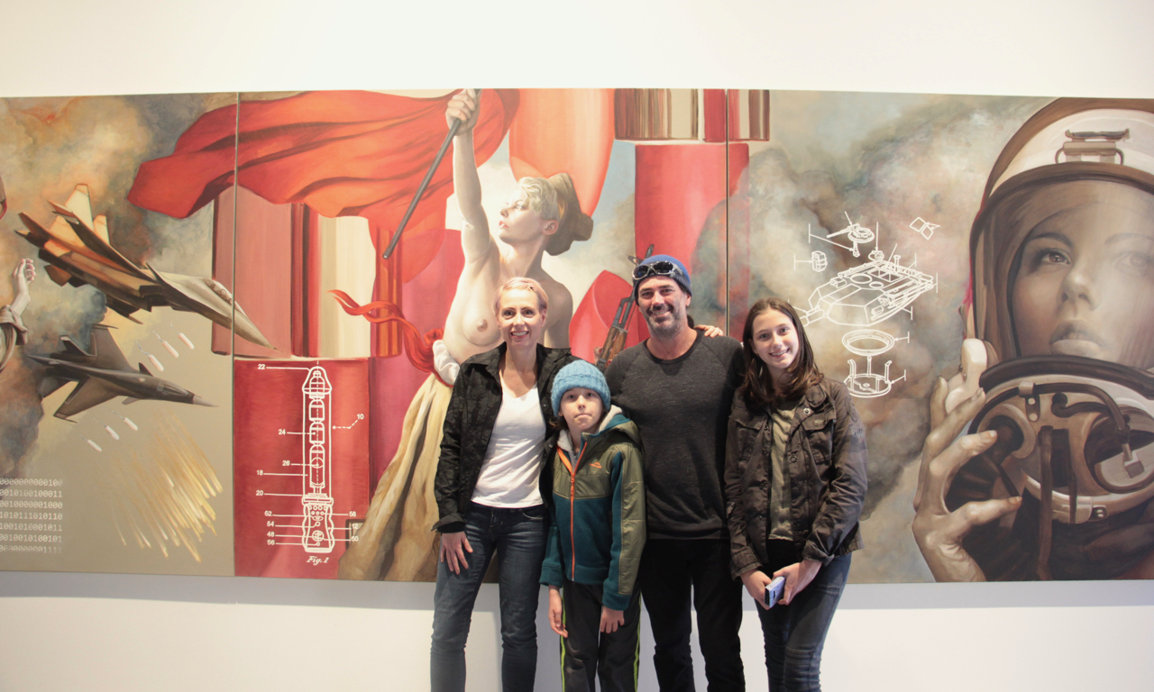 Kathrin Longhurst and family in front of a triptych which is in the Bennett Collection of Women Realists Paintings