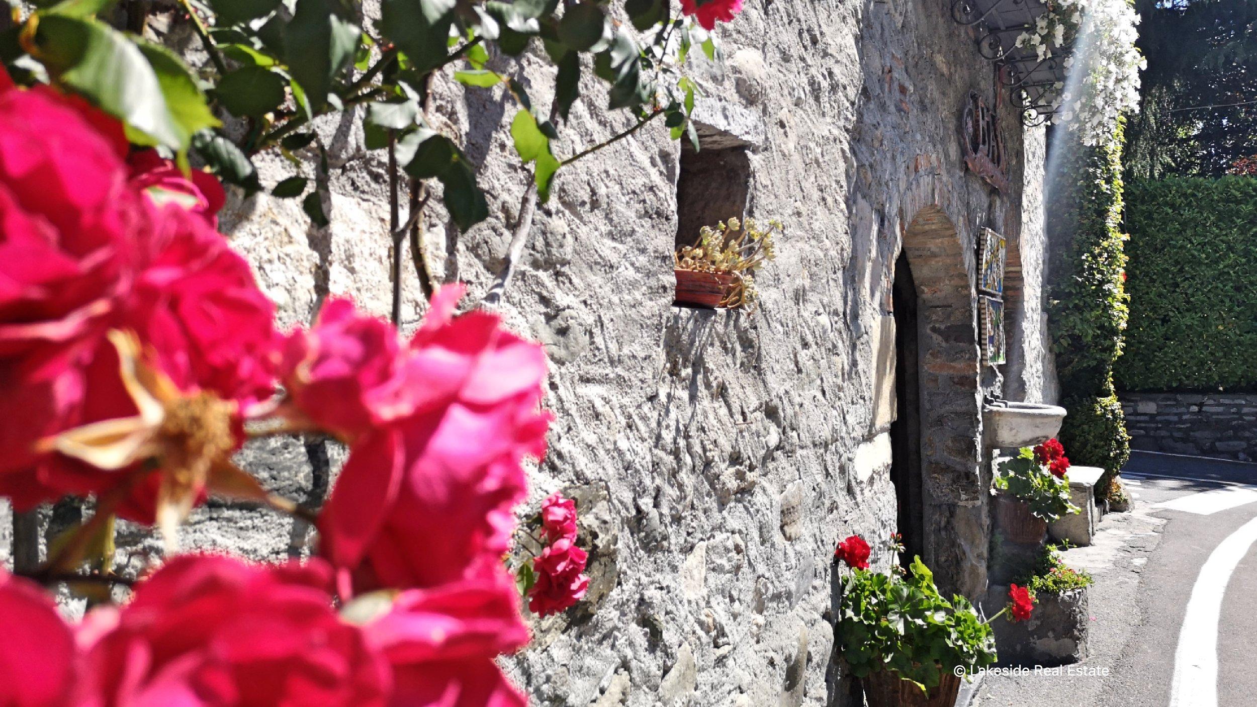 The charming rustic facade of Vecchia Torre pub in Griante