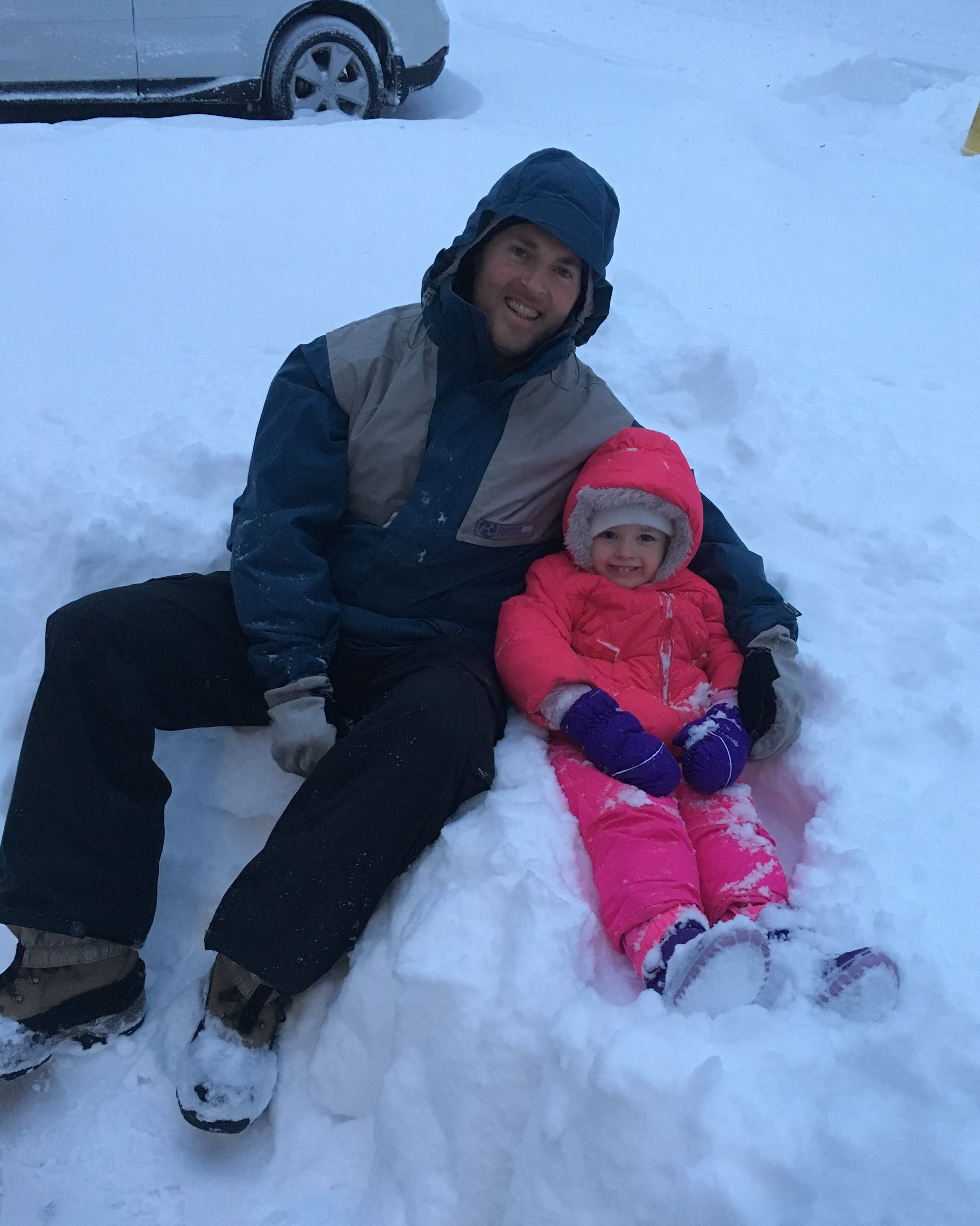 Fun in the snow with dad