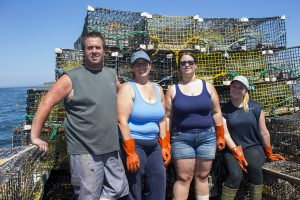 Robert Young, left, his wife Kristie, and family are moving ahead with their new business, Vinalhaven Smoked Lobster. Photo courtesy of R. Young.
