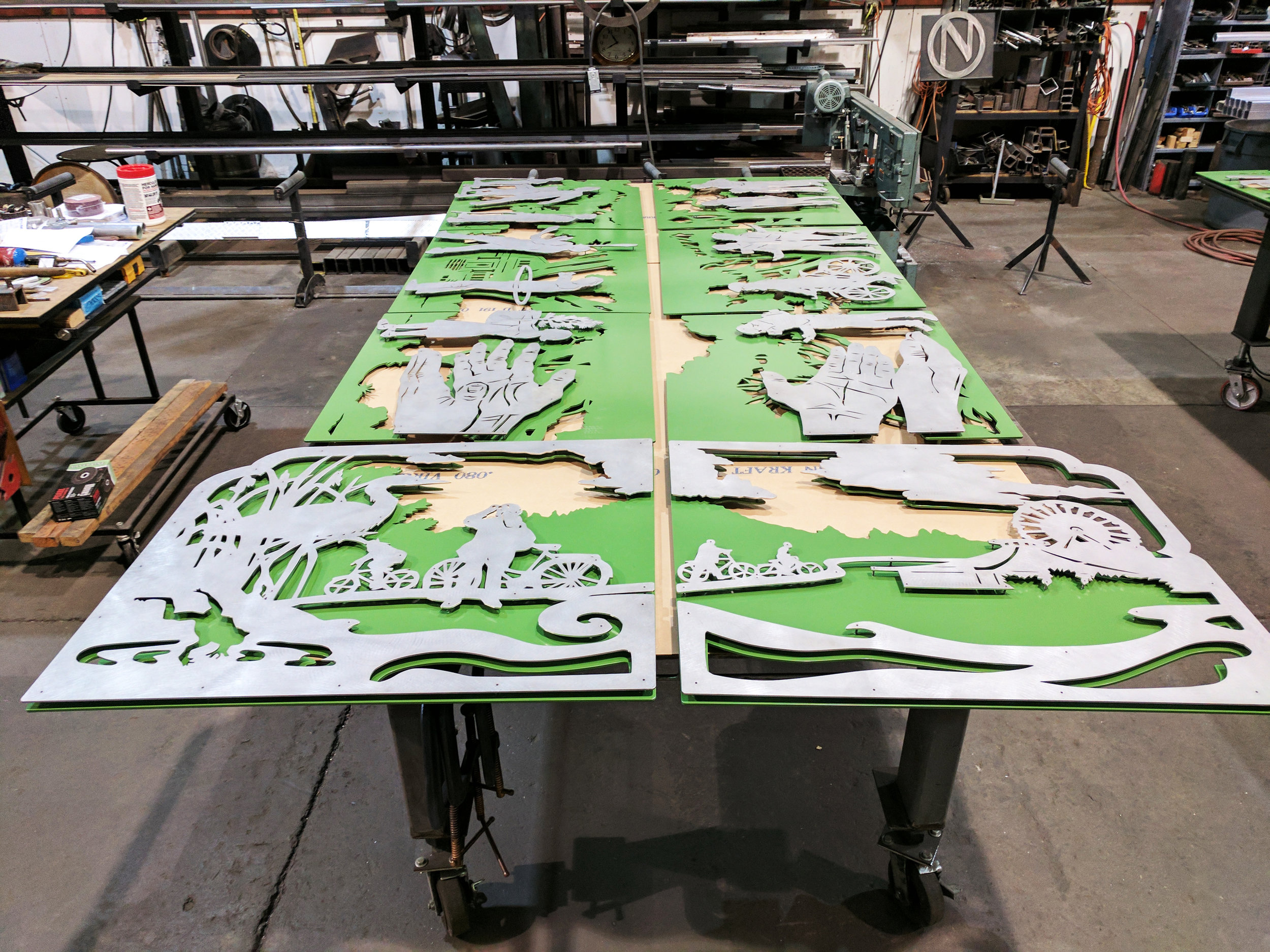 Laser Cut Layered Powcer coated Panels for Eugene Oregon EMX Station