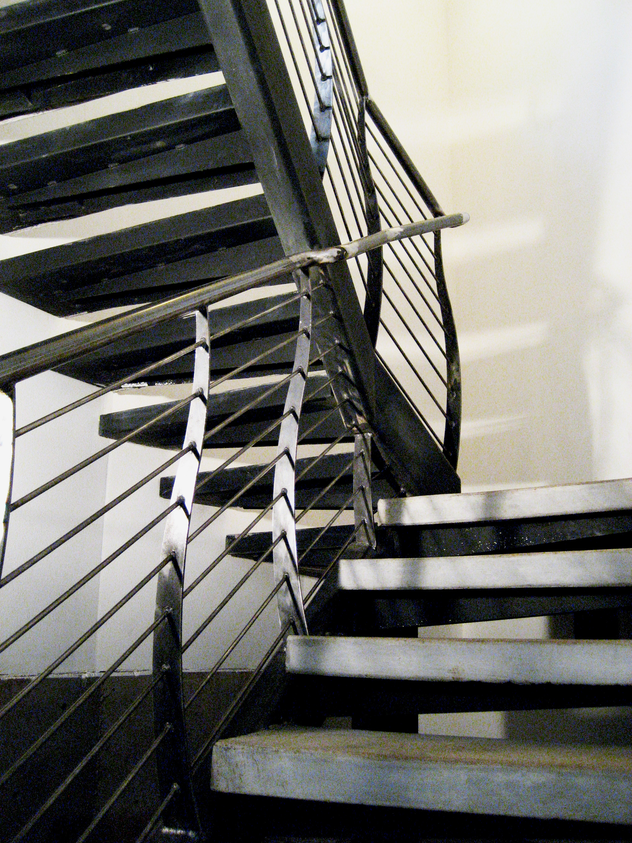 Stairwell Handrail with Curved Balusters