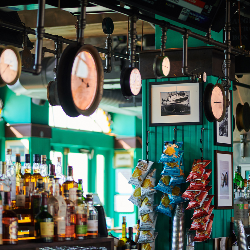 bar with chips and metal piping in Battery Park, FiDi 10004 – Oyster House at Pier A NYC.jpg
