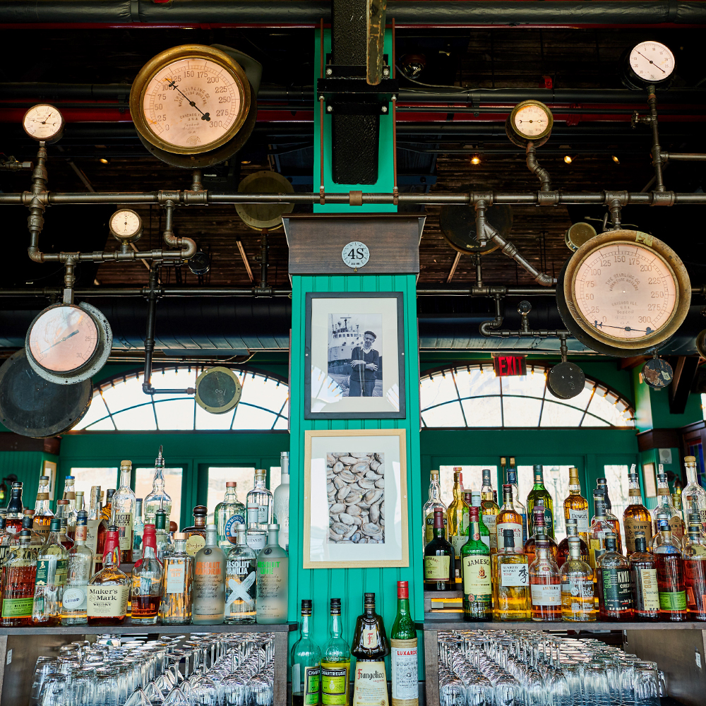bar with spirits and drinks in Battery Park, FiDi 10004 – Oyster House at Pier A NYC.jpg