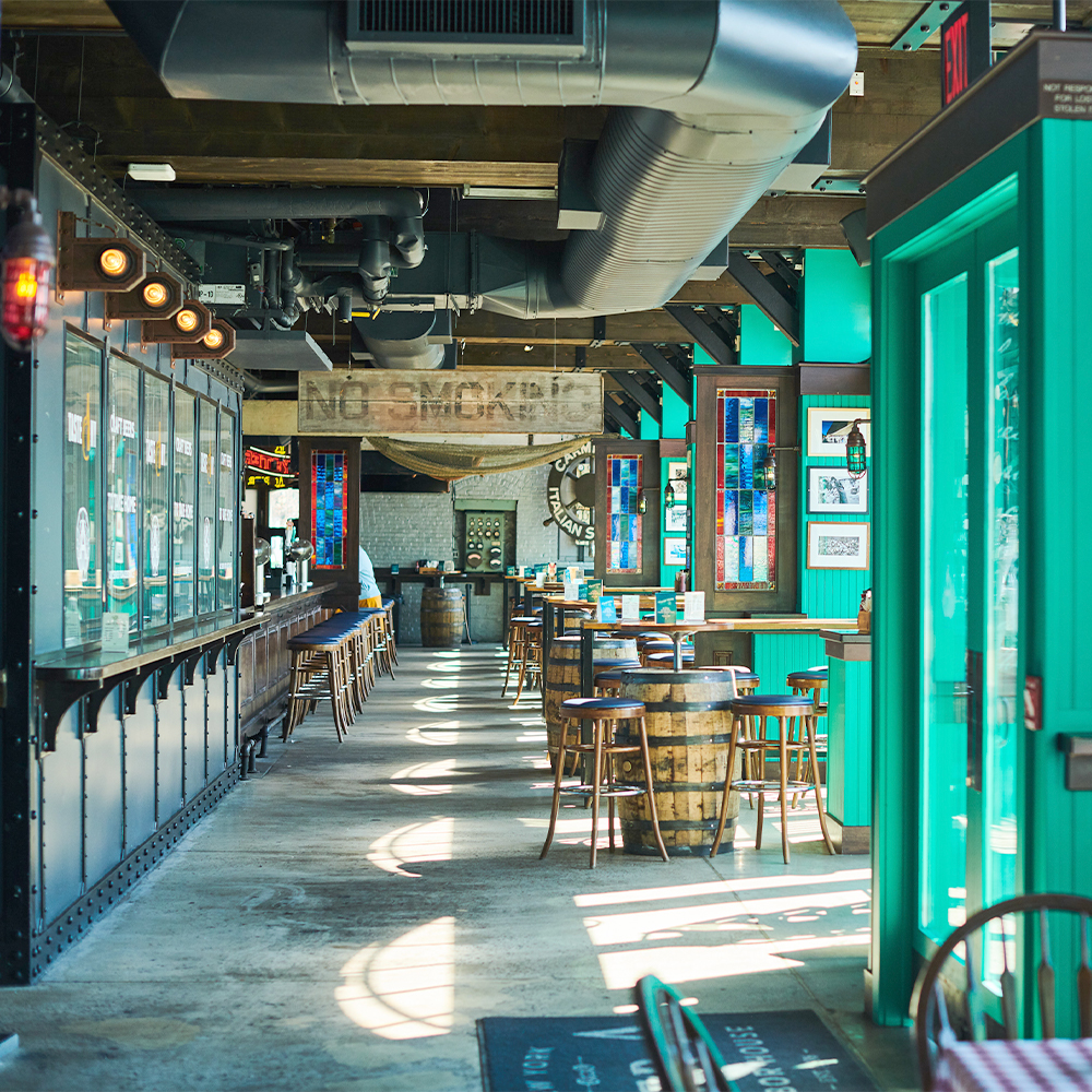 massive bar seating area for seafood restaurant, gingham tablecloths and shucking spot in Battery Park, FiDi 10004 – Oyster House at Pier A NYC.jpg