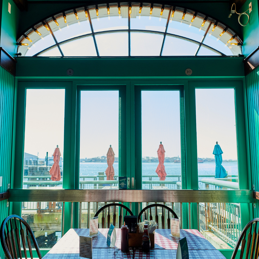 seating area for seafood restaurant in Battery Park, FiDi 10004 – Oyster House at Pier A NYC.jpg