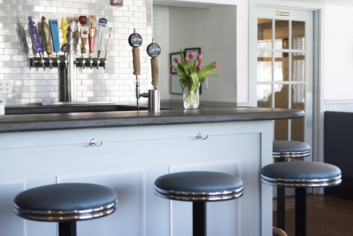 view-of-bar-beertapinbackground-vase-of-tulips-on-tabletop.jpg