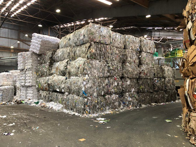 Bales of plastic are piled at a Recology facility in San Francisco. (Alana Semuels / The Atlantic)