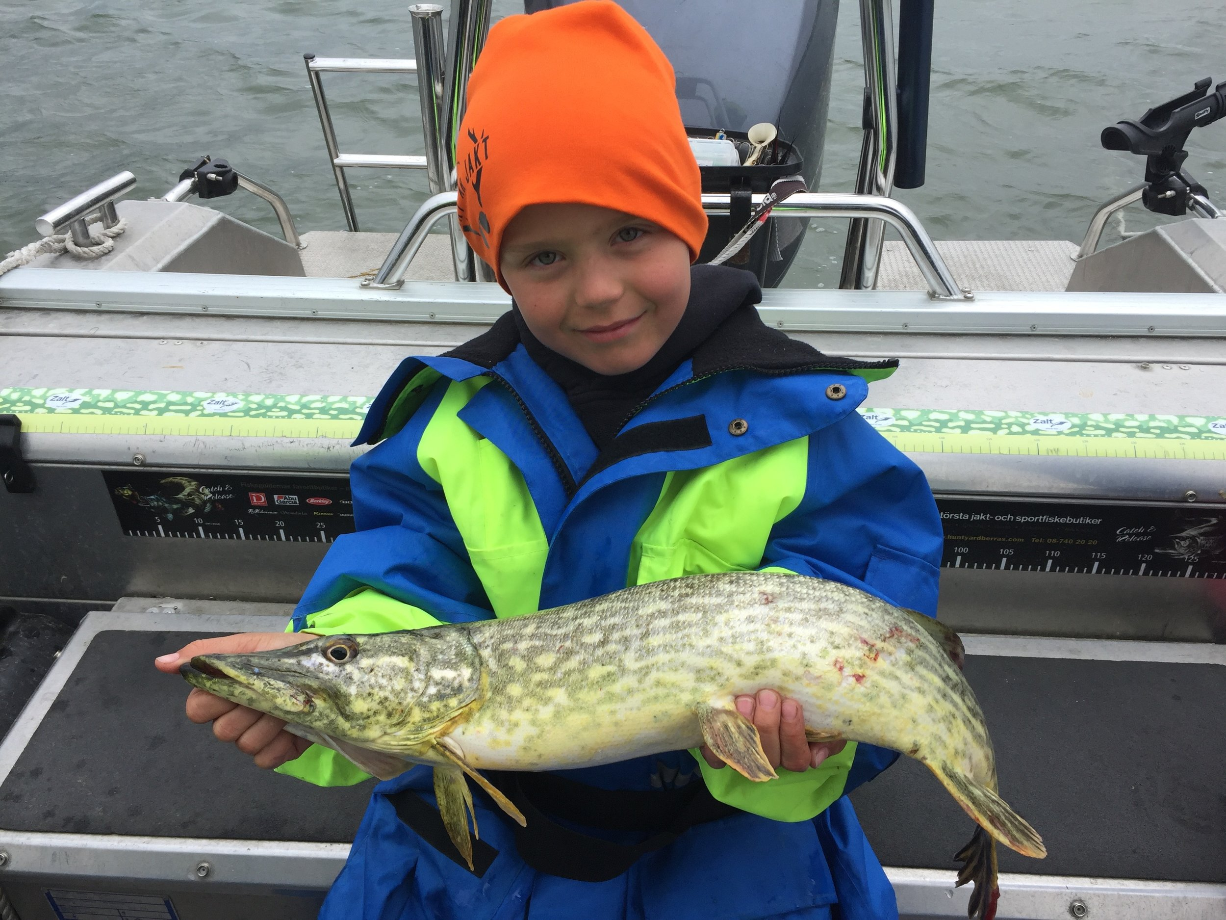 little guy with his first pike trosa fishing guide.jpg