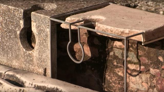 Ruins of ancient Roman public toilets. Concrete replica on the left.