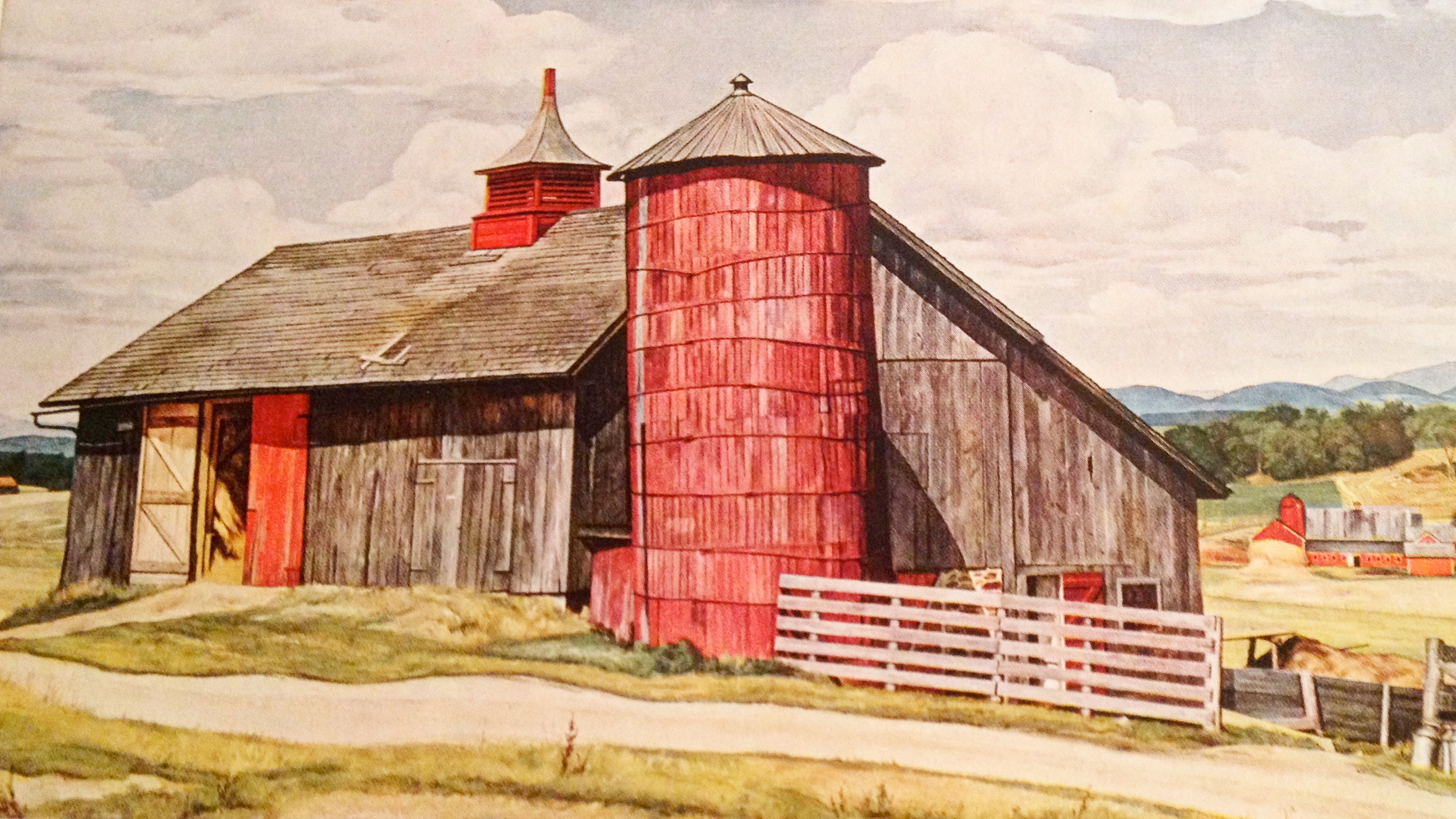 """Luigi Lucioni was an Italian-born American painter and printmaker who painted the """"Old Black Barn"""" in the mid-1900s. This barn (with a fresh coat of paint) is now called the Sheep Barn and is still in use today."""