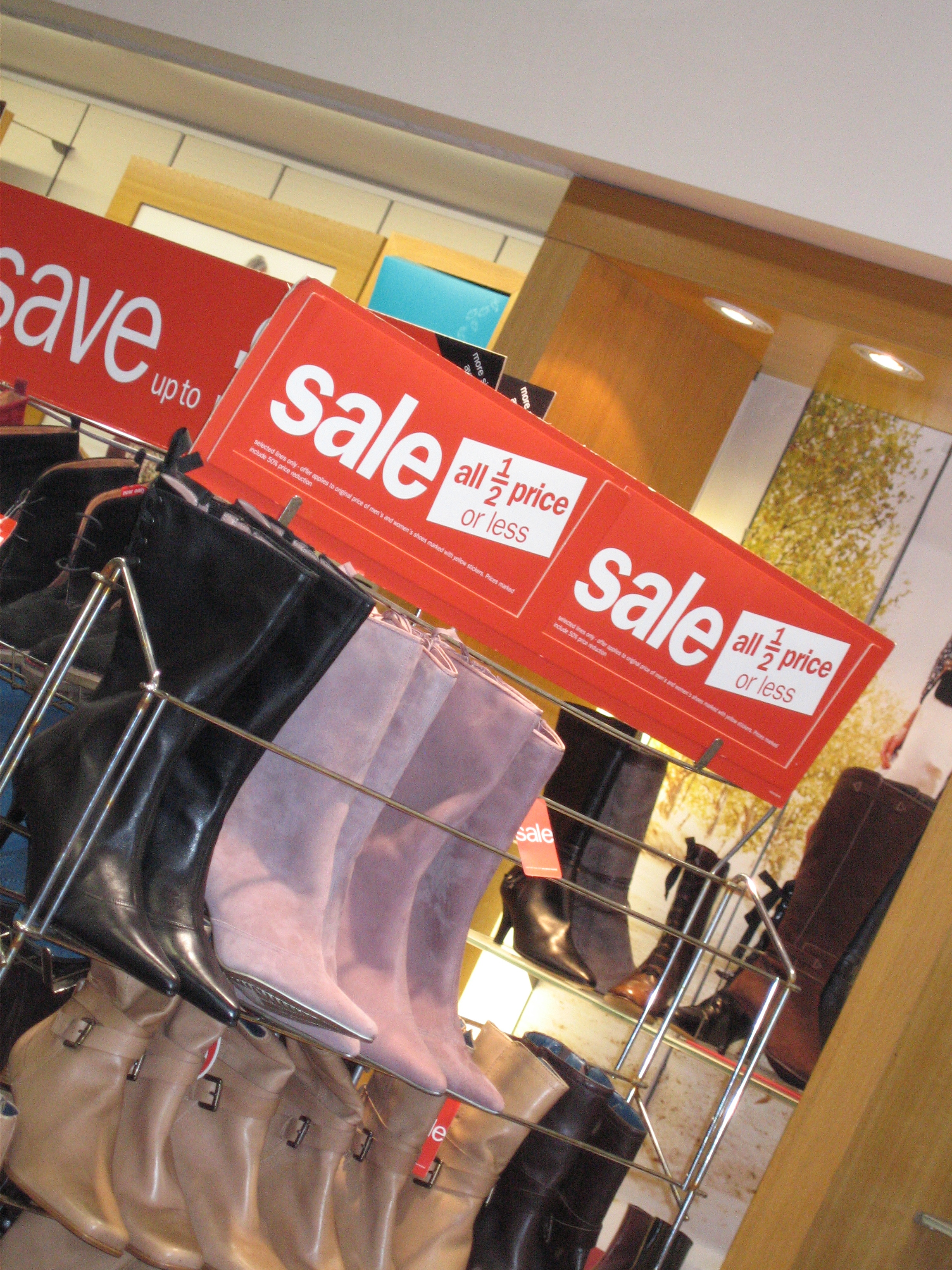 sales-posters-up-in-shop-windows-before-Christmas-in-harsh-retail-conditions-in-2005-Kingston-London-England-3-DHD.jpg