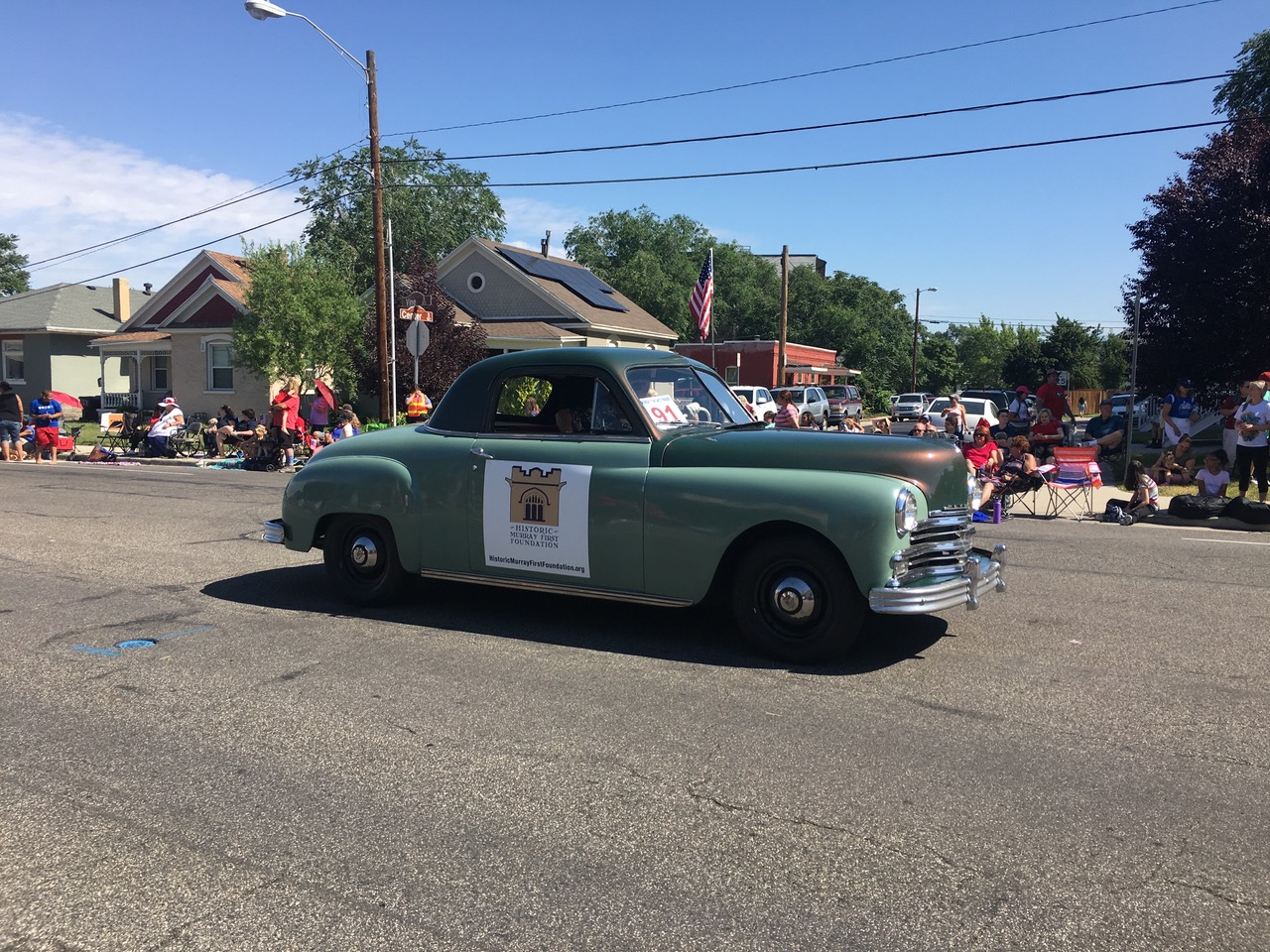 Mr. Mike Burn and his 1949 Plymouth advertising for Historic Murray First Foundation in the Murray 4th of July Parade