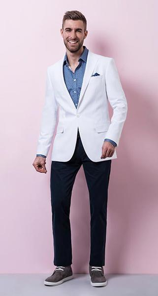 Casual with a Twist - The white cotton blazer and printed shirt, teamed with the navy pants and pocket square are conventional, but with a little personality.