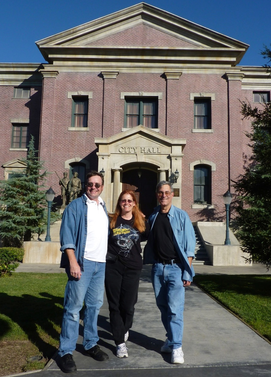Oliver Holler, Terry Holler and Bob Gale on the Hill Valley Courthouse Square set at Universal Studios Hollywood.