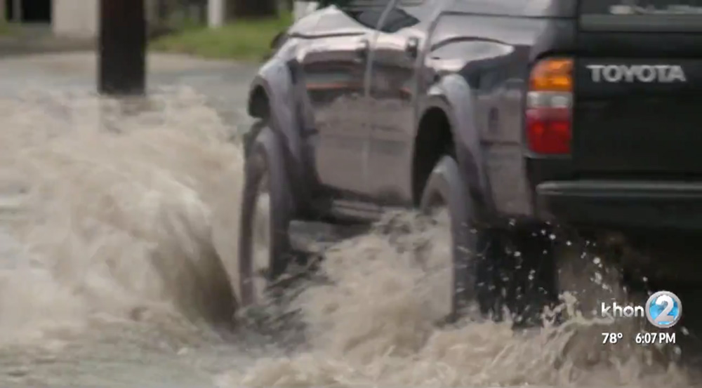 Truck driving through rising waters