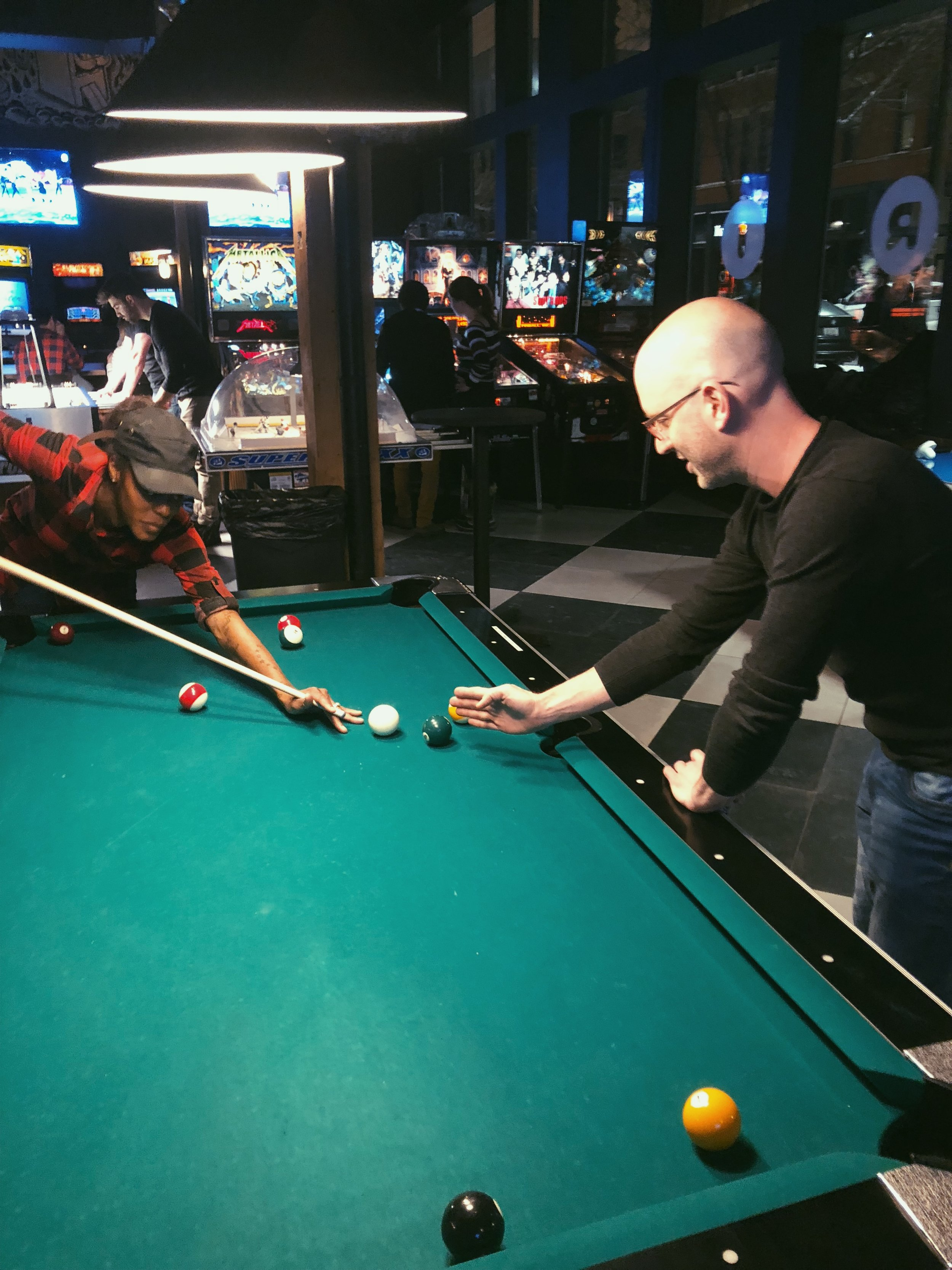 Shawn giving Shay pro tips at pool.