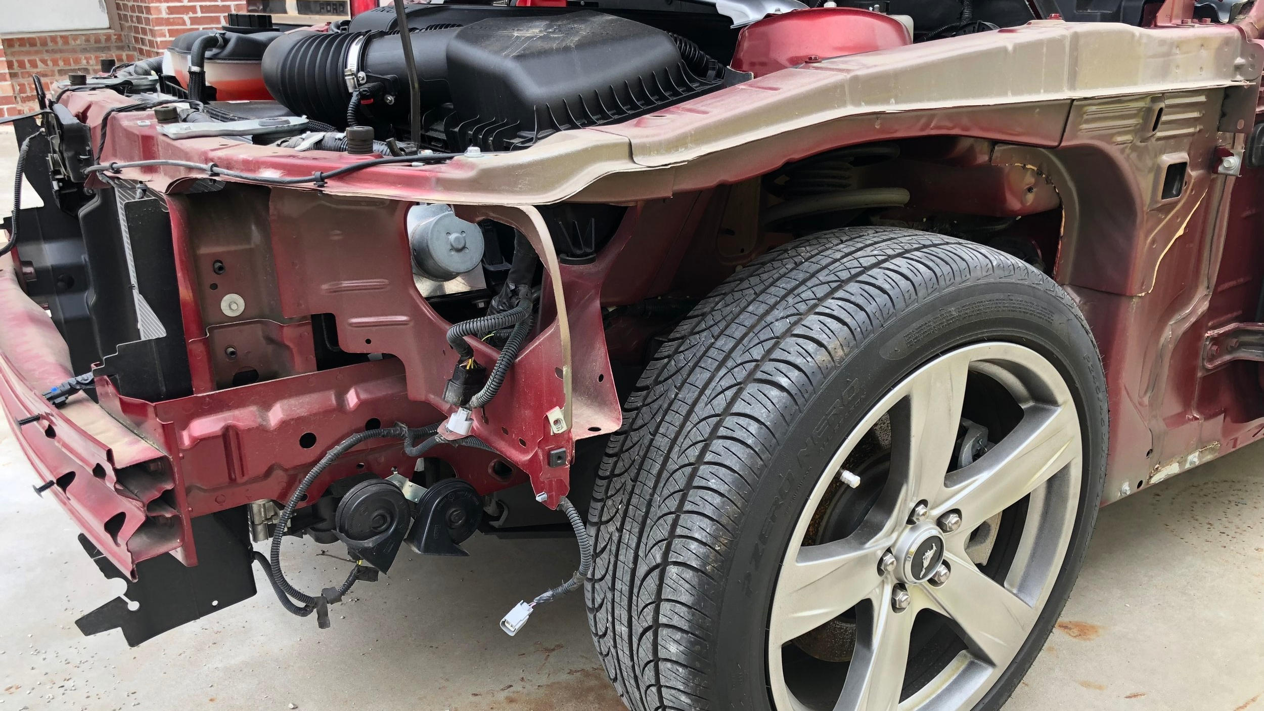 The exterior is stripped from the donor Mustang, and the conversion is now underway.