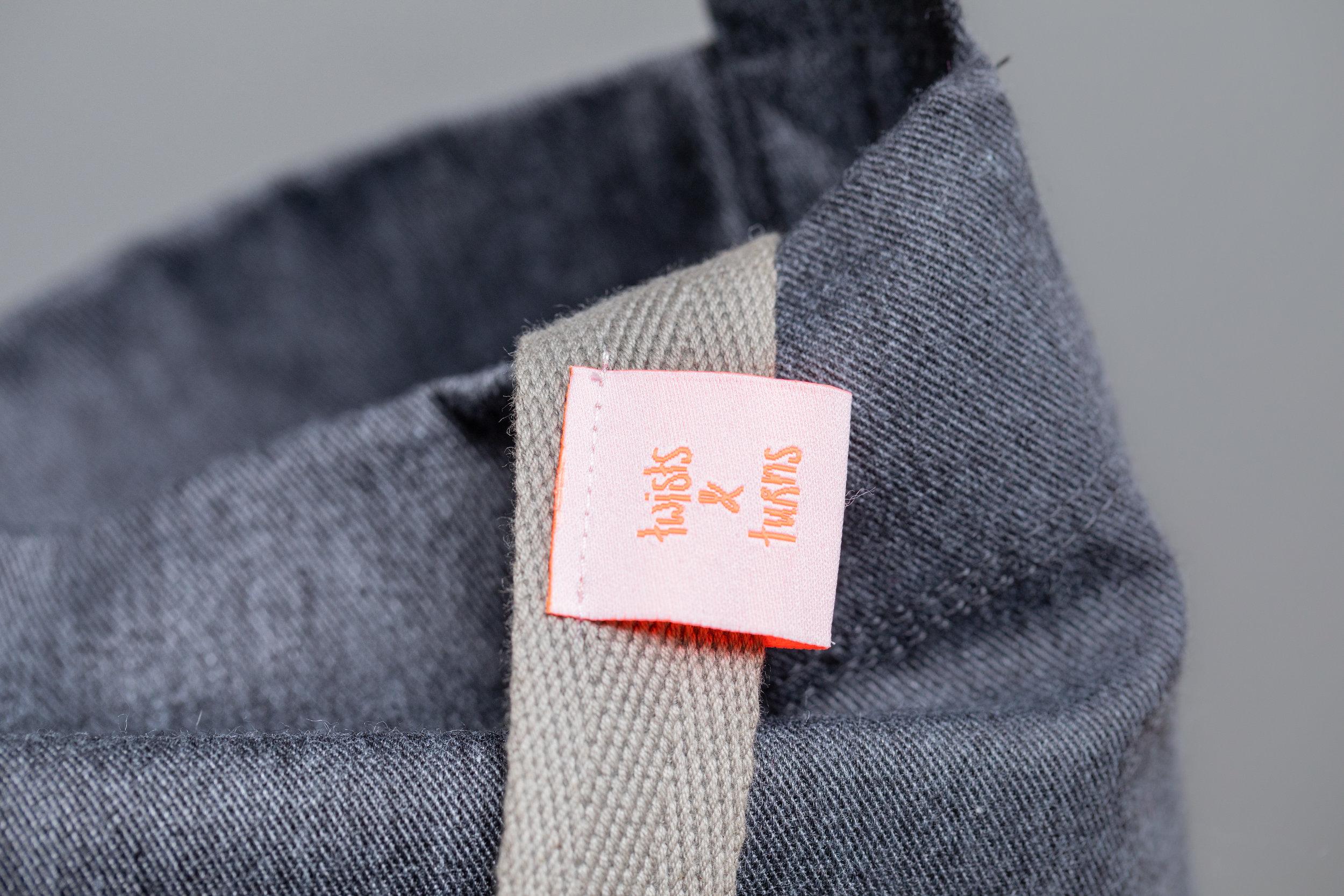 twists and turns tote bag nin detail label.jpg