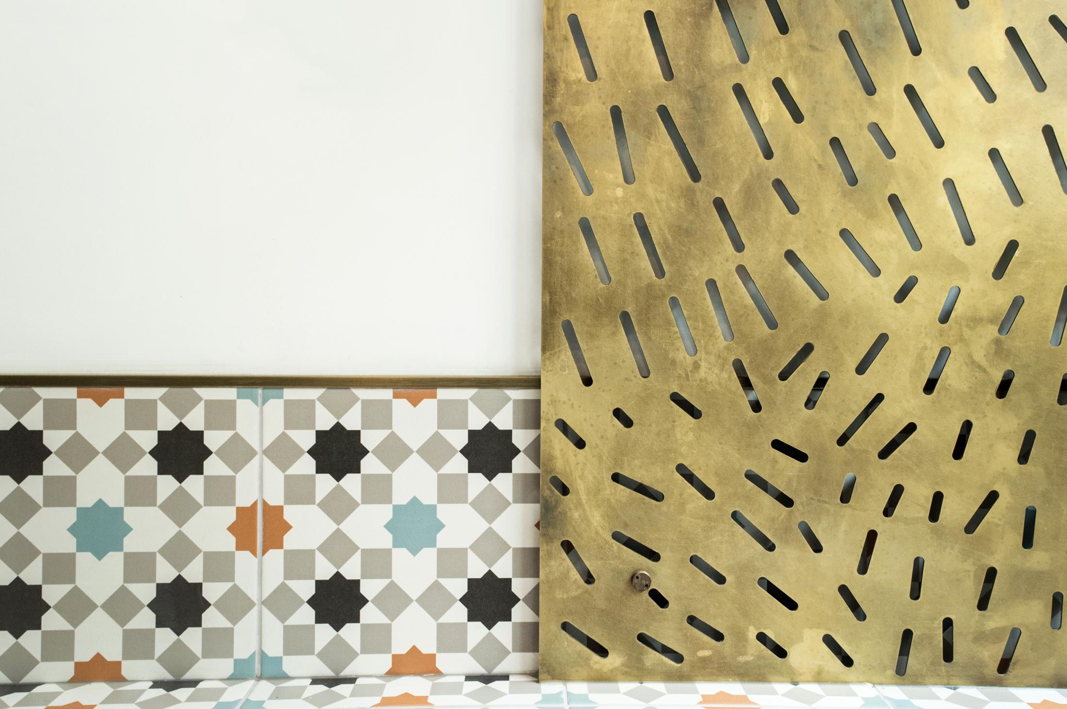 Ensemble Wells Restaurant Tiles and Brass Details