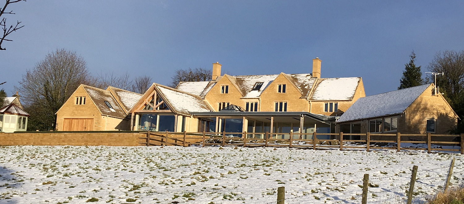 2b-rear-elevation-in-snow-from-the-valley-(1).jpg