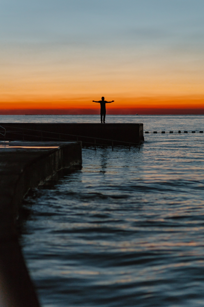 kaboompics_The man is looking at the sunset by the sea (1).jpg
