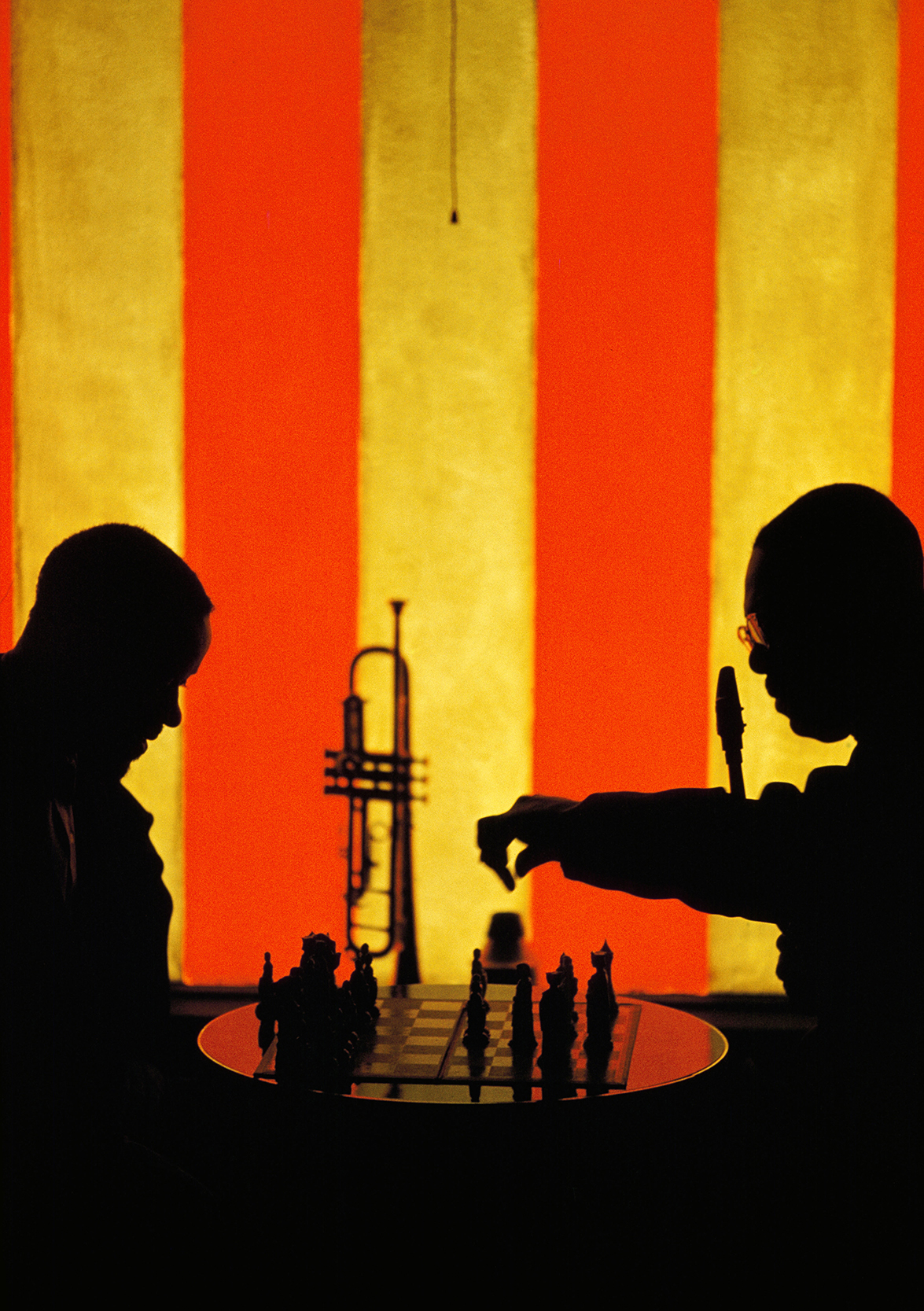 Burt Glinn, 1960.    Earl Bostic and his trumpet player playing chess during a break at the Blackhawk. That is the sun coming through the red and white striped window. Pretty jazzy eh, Dad? This is the end of Take One.
