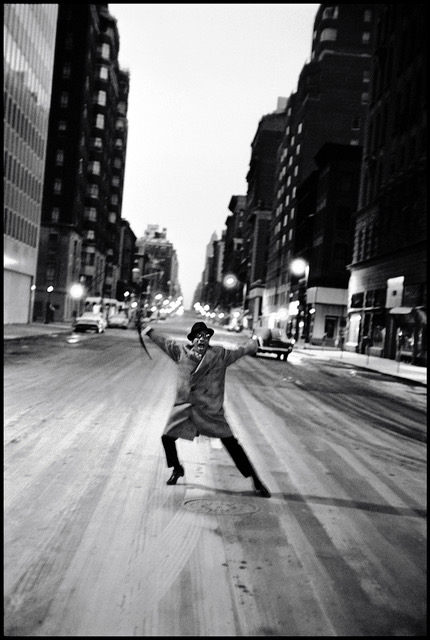 Burt Glinn (1925-2008)   USA. New York City. 1959. Sammy Davis Jr. dances across Madison Avenue after his last show at the Copa Cabana.  16 x 20 inches  40.6 x 50.8 cm