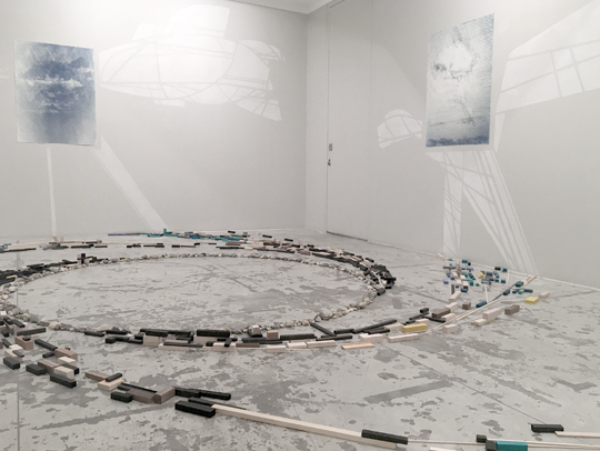 Nick Lamia   Stormwatch , 2018 Site-specific installation Set of 6 Cyanotypes, printed by the artist Re-purposed wood, Hudson River stones and chalk Dimensions vary.