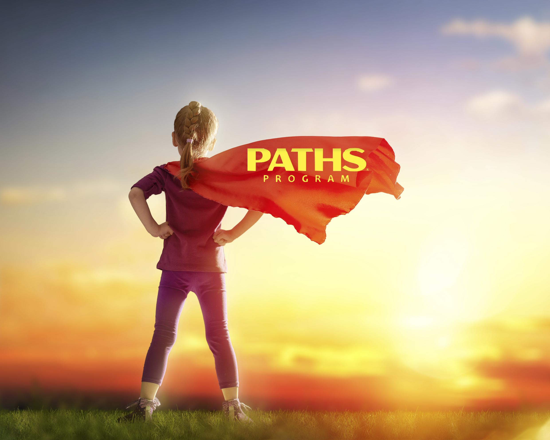 iStock_85343257_LARGE girl w: cape & PATHS logo.jpg