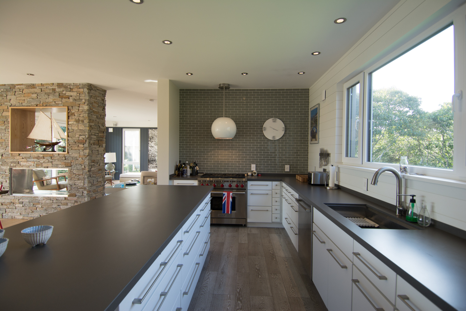 Modern galley kitchen with long window over the sink