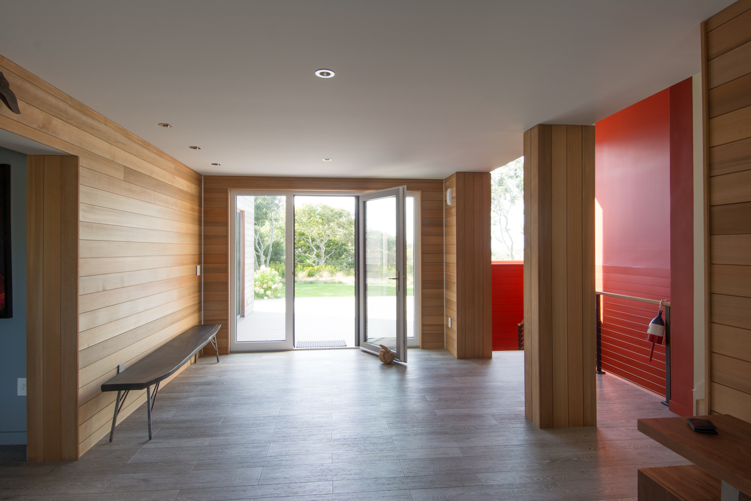 Interior hallway with wood paneling and bench