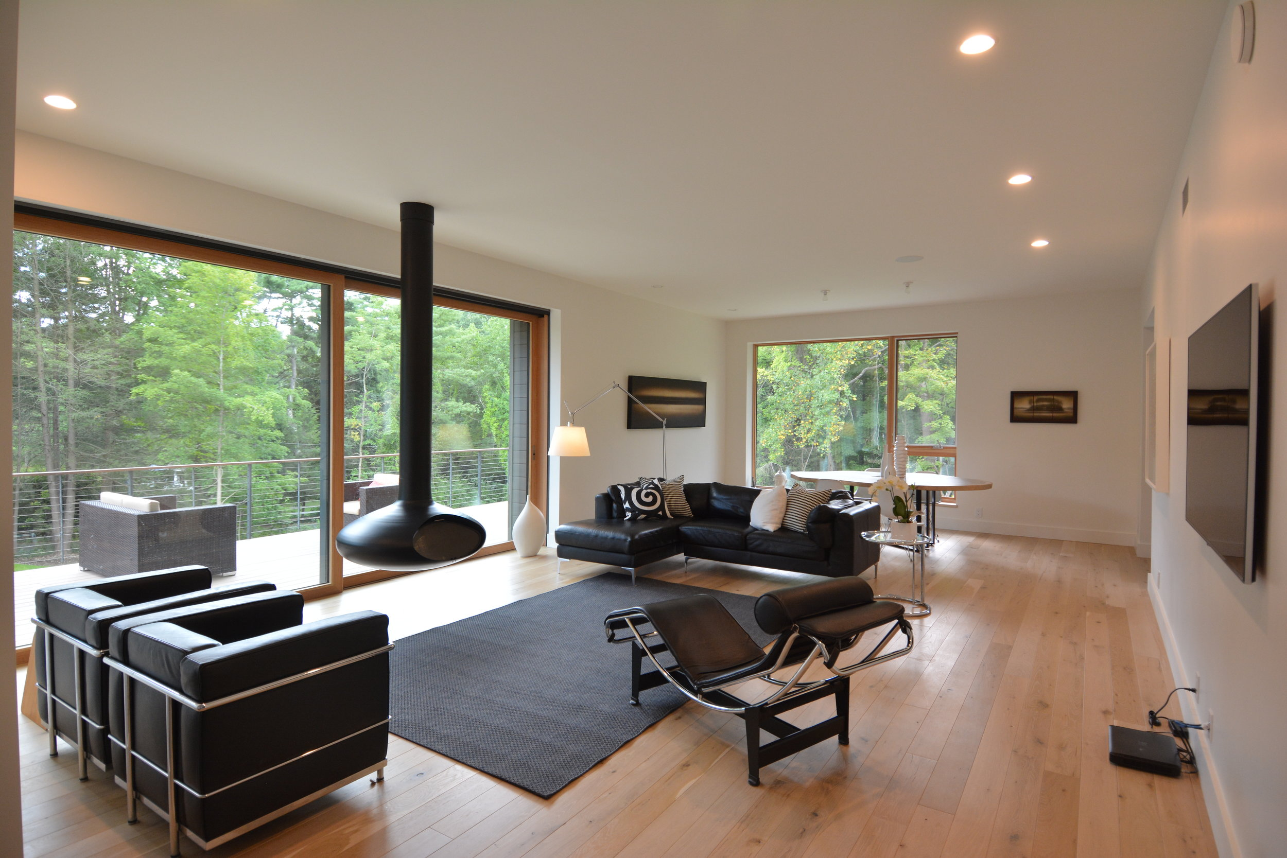 Living room with large sliding doors and suspended fireplace