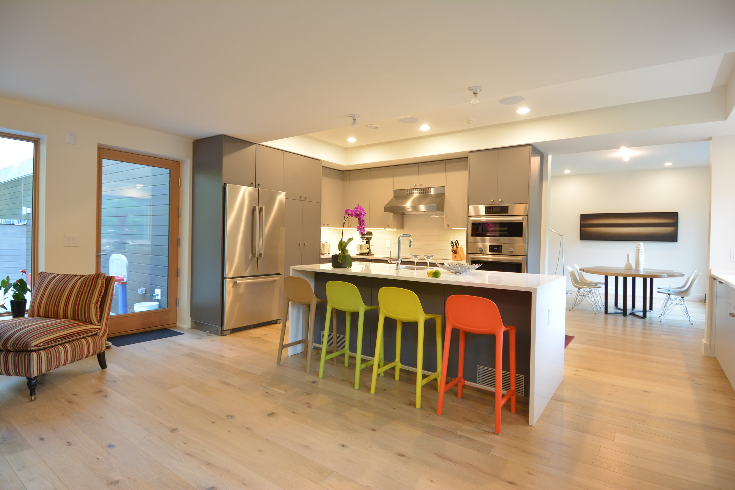 Breakfast bar and kitchen with colorful stools