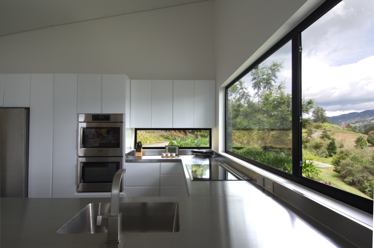 Kitchen with large windows and double wall oven