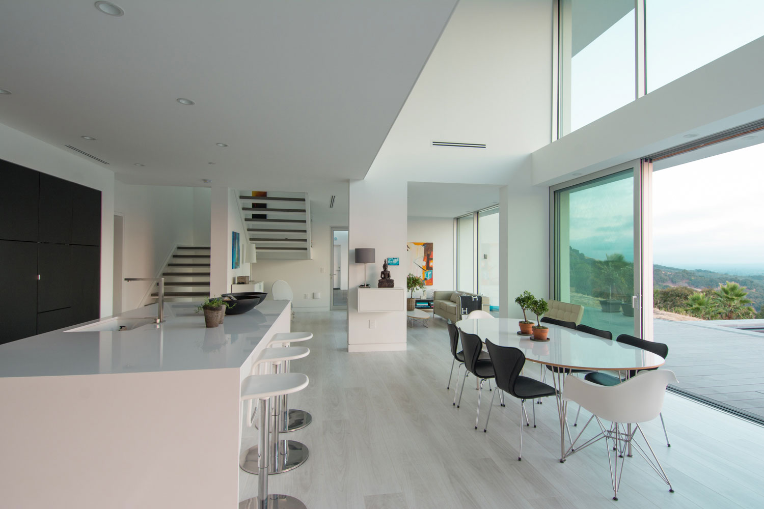Open plan modern kitchen and dining room with view