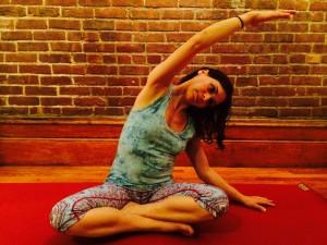 1-Seated-Side-Bend-Yoga-Shayna-Skarf-Textbookscom-Blog-300x225.jpg