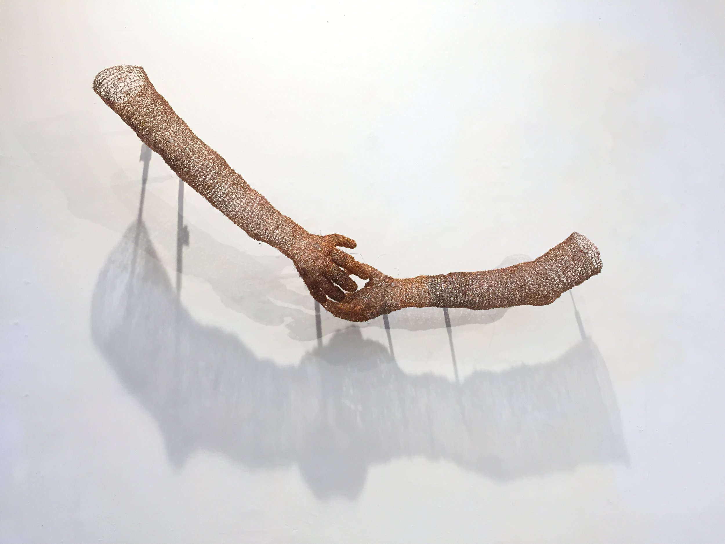 """Handshake"", recycled copper wire"