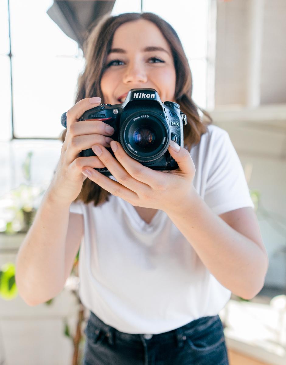 Woman smiling behind camera