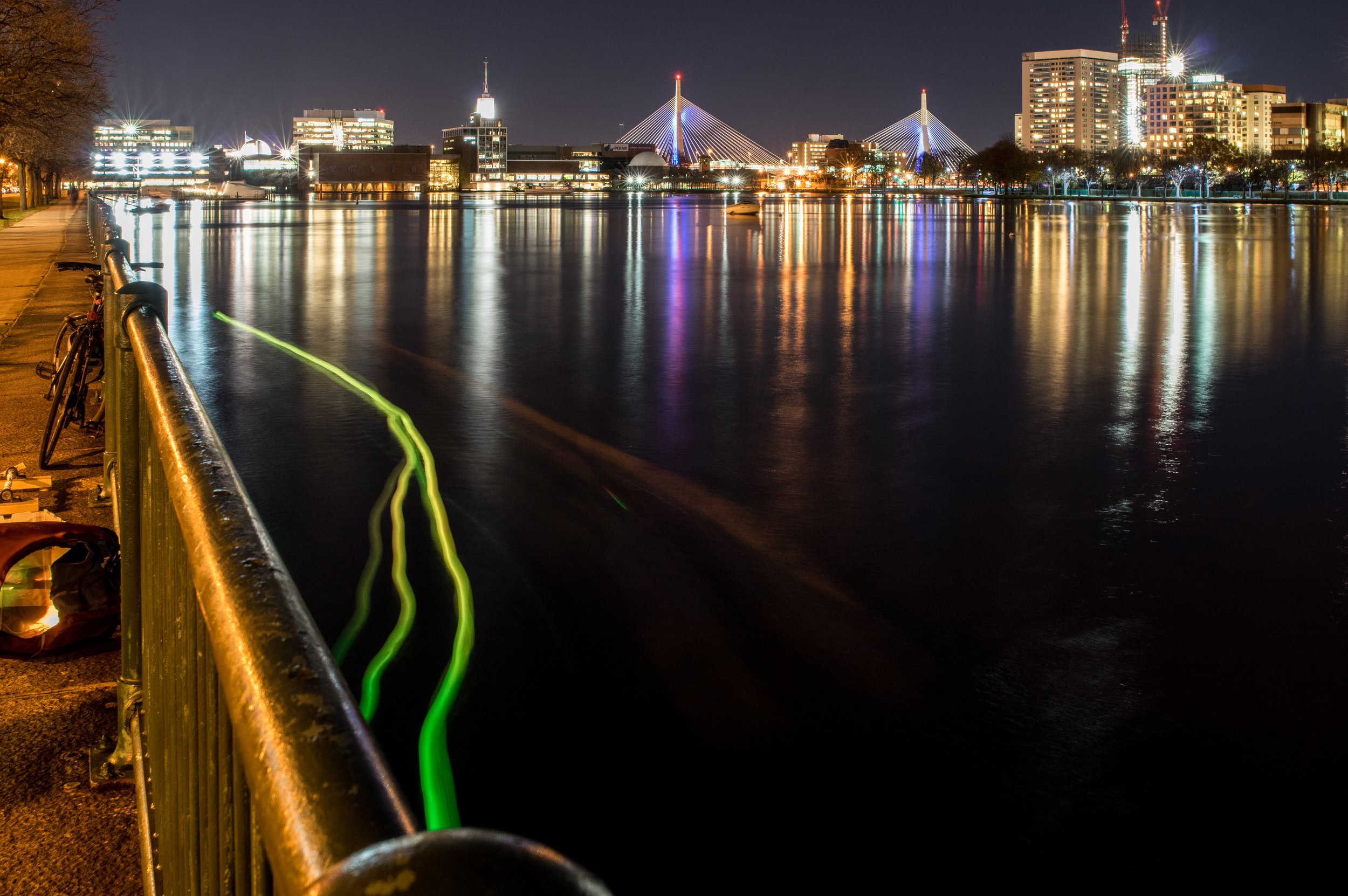 A long exposure image from an early SeeBoat test near the Kendall Cogeneration Station, November 20th, 2015. The change in color from green to yellow is tied to the temperature sensor readings and indicates a potential thermal pollution source near the outflow pipe. New infrastructure and protocols at the plant intended to eliminate thermal pollution were completed in 2016.  SeeBoat: Kendall Cogeneration Station, 2015 // project: Laura Perovich & collaborators // photo: Jorge Valdez