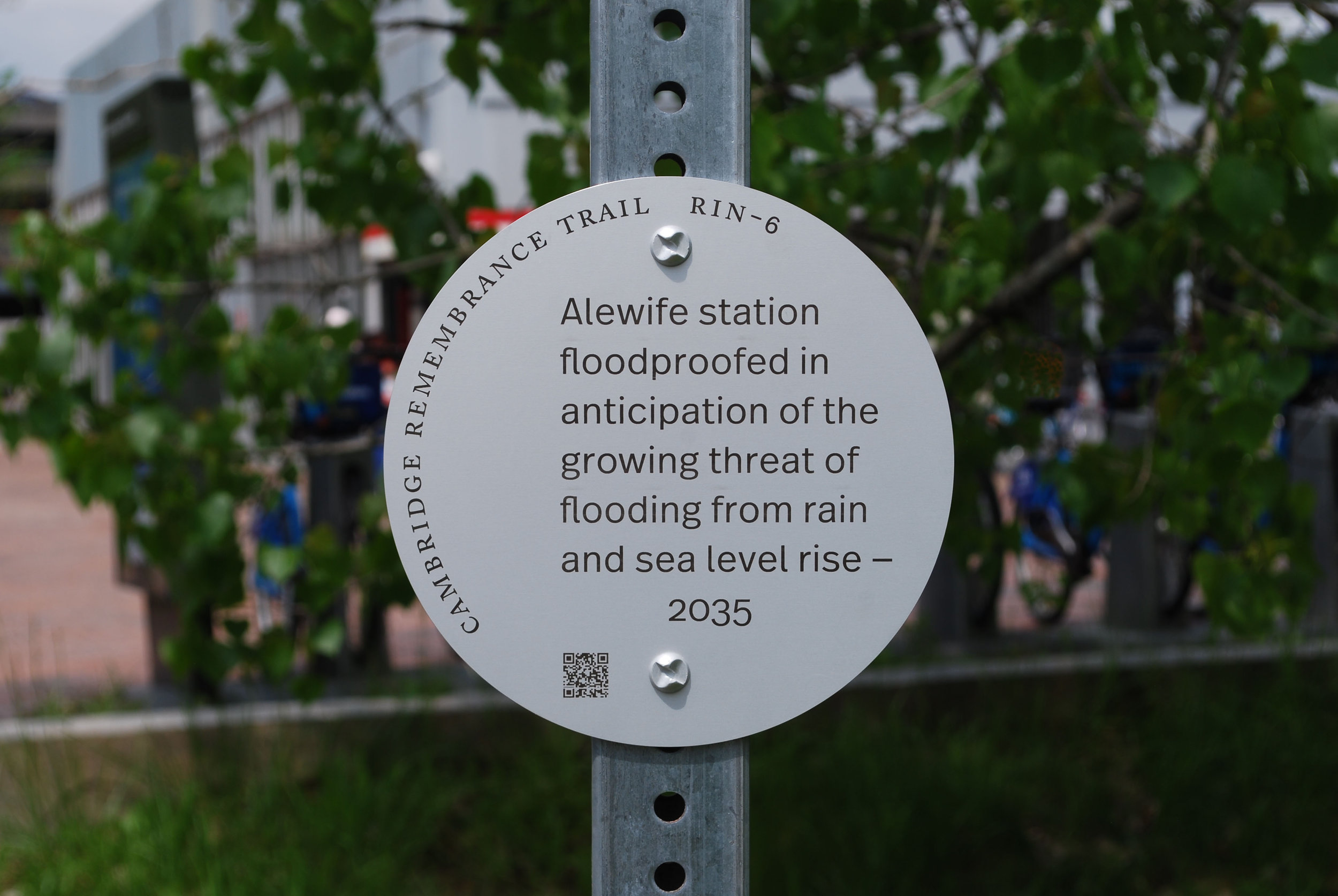 8-inch diameter plaque attached to street sign pole