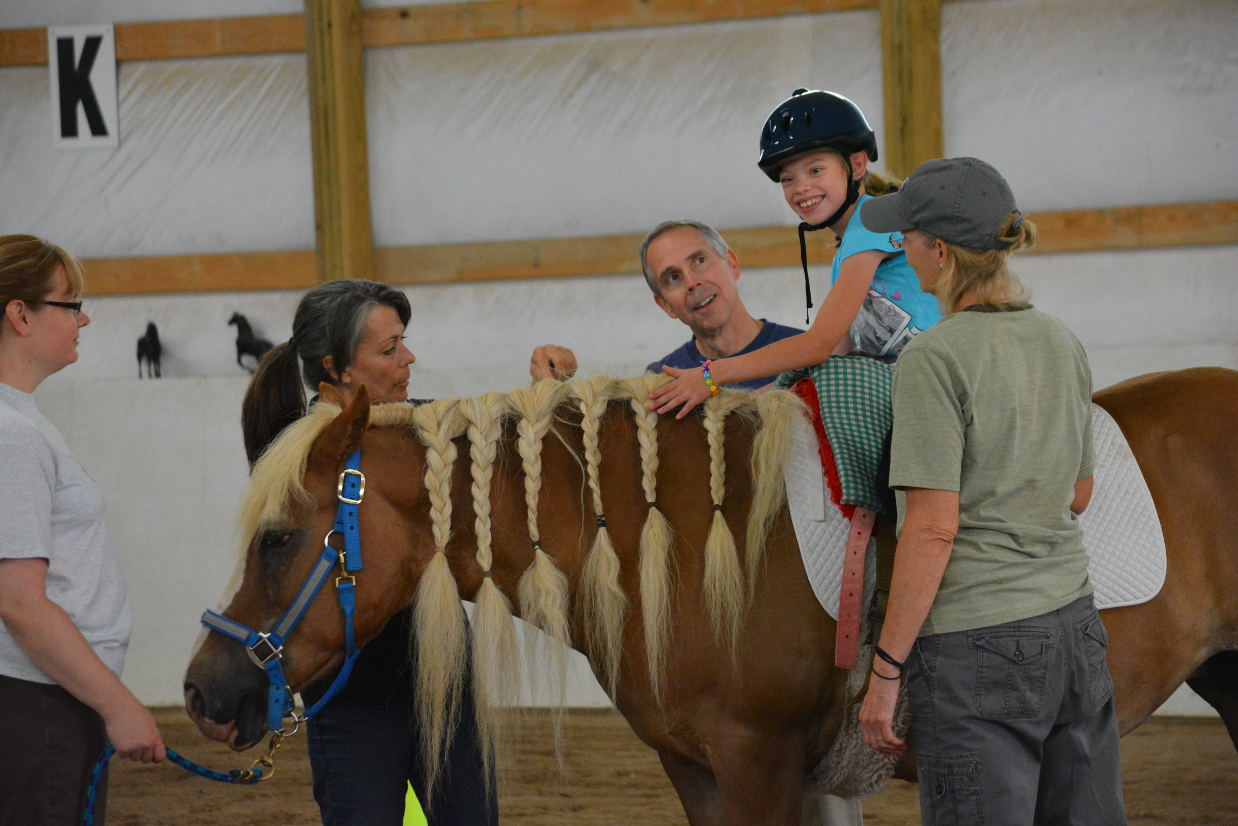 Arena Volunteers - Volunteers serve as sidewalkers and horse leaders. They directly assist participants with riding or ground lessons.