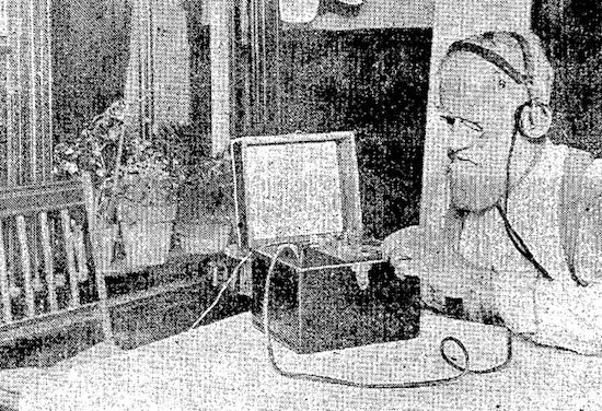 A man listening to the radio transmission of an opera (February 26, 1922 Ogden Standard-Examiner)