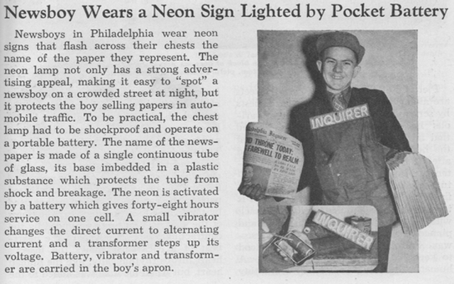 A newsboy from Philadelphia wears a neon sign to sell his papers in 1937 (Novak Archive)